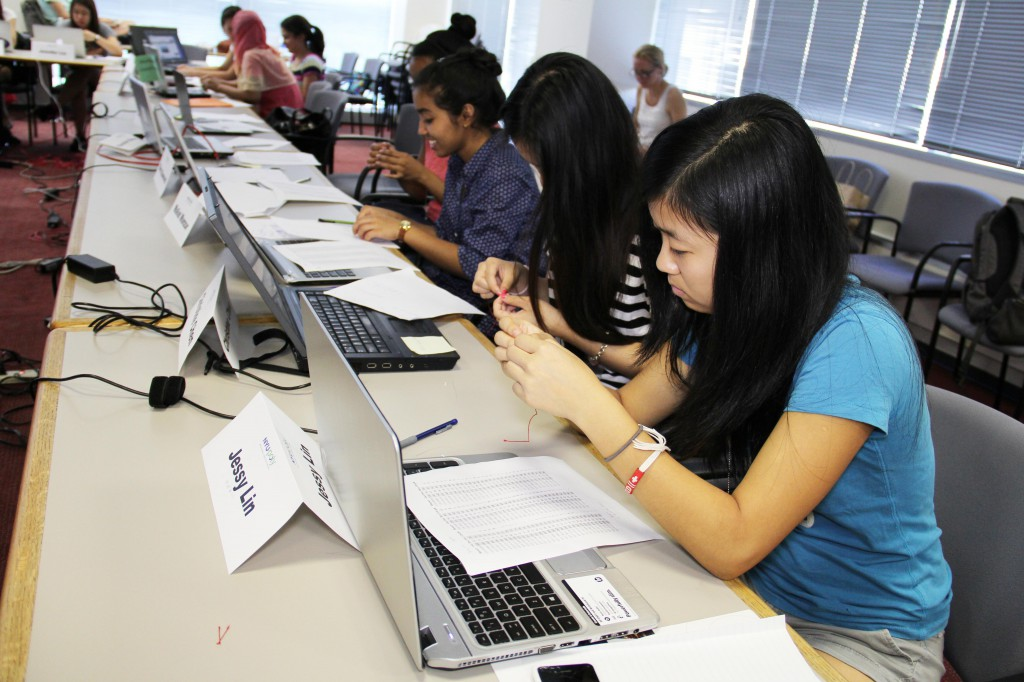Local students participated in a hands-on computer science learning activity on campus. These could be your students, learning from a computer science lesson you devise after a summer of research and training.
