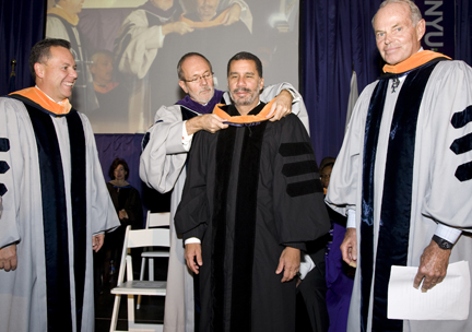 President Hultin presents Governor Paterson with NYU-Poly's first honorary doctorate.