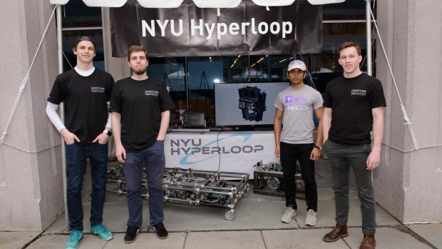 NYU Hyperloop team members with their prototype vehicle at the 2017 NYU Tandon Research Expo