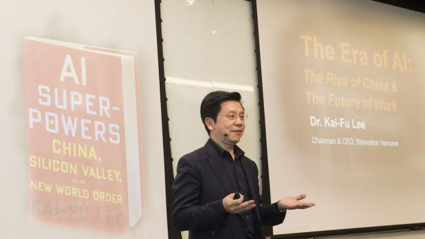 Kai-Fu Lee with image of his book projected behind him