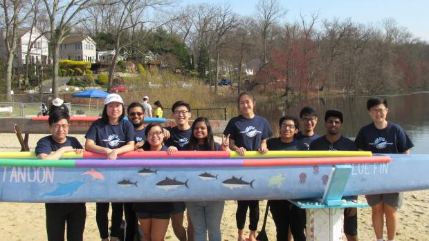 canoe team with boat