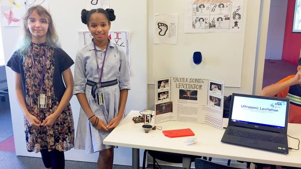 middle school students stand by their project