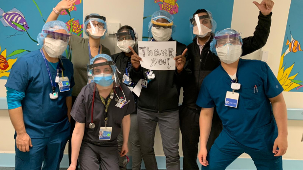 group of doctors wearing face shields