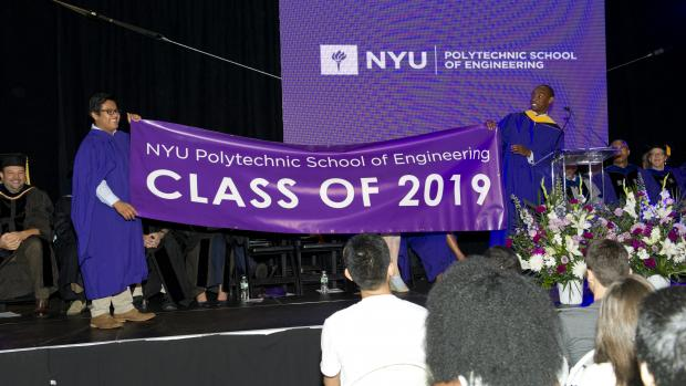 Students holding up 2019 banner