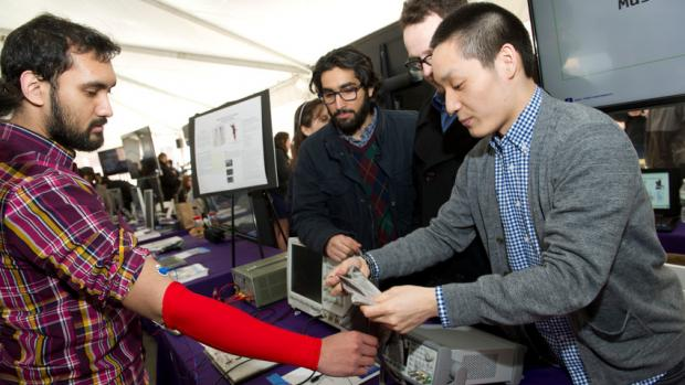 Student testing a project at NYU Tandon's Research Expo