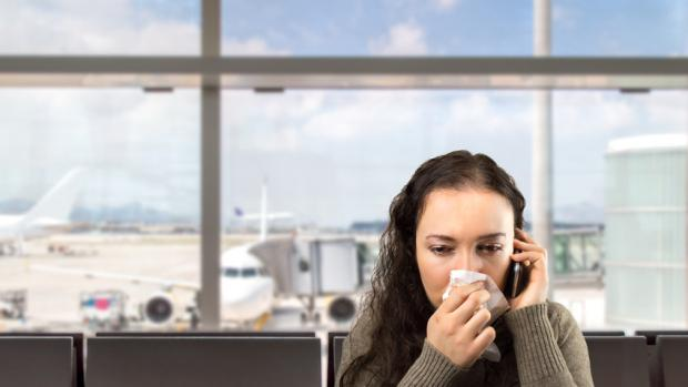 Stock photo of a woman wiping nose