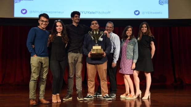 Winners of the NYU-Yale Pitchoff Anthony Oganov (third from left) and Amar Seoparson (holding trophy) flanked by competing participants of the Summer Launchpad program.