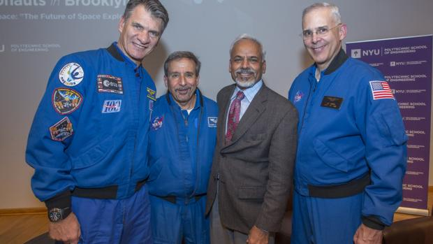 Paolo Nespoli (left), pictured here in 2014 with Dean Katepalli Sreenivasan and fellow astronauts Charles Camarda and Lee Morin