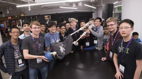 CSAW participants holding a skeleton