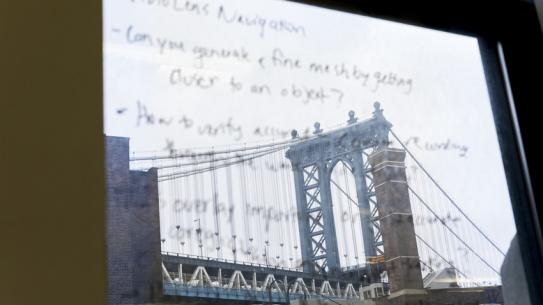 Photo of a bridge superimposed with text.