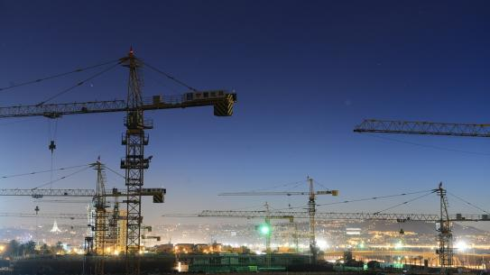 image of cranes at night time