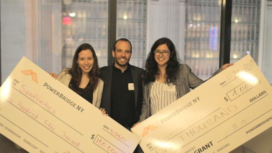 Professor Miguel Modestino with Ph.D. candidate Daniela Blanco, and alum Myriam Sbeiti after winning $150,000 the PowerBridgeNY competition.