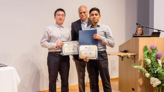 Arun holding Dante Youla Award for Graduate Research Excellence