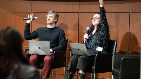 NYU Tandon professors sitting on panel raising their hands