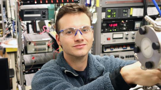 Caspar Lant wearing safety goggles in a lab