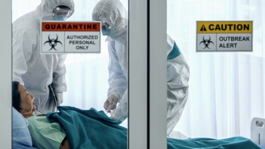 person in quarantined hospital bed