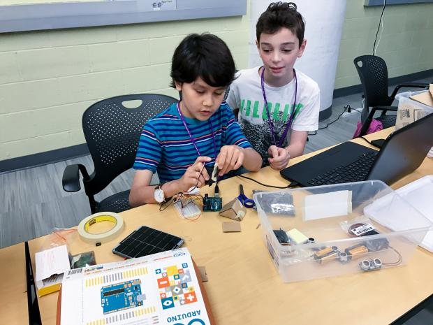 kids working on a motherboard