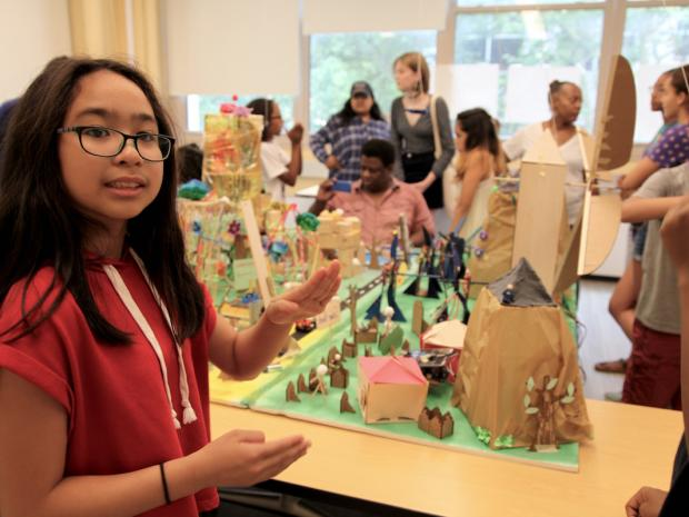 A Science of Smart Cities participant shows off the features of a city she and her teammates created.