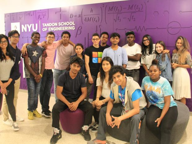 group of students posing in front of makerspace