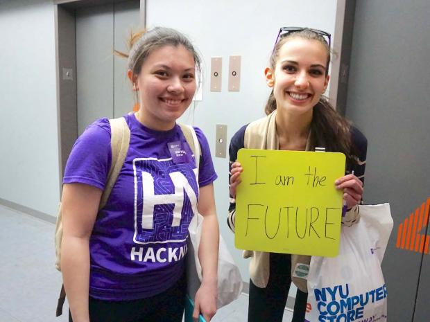 "2 female students holding sign ""I am the future"""