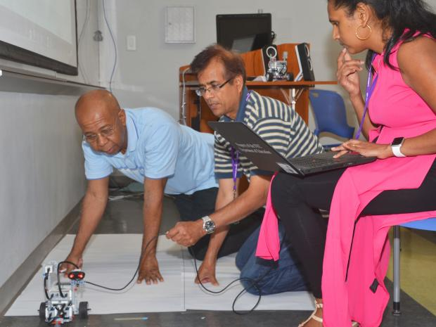 Teachers working on a robot's movement
