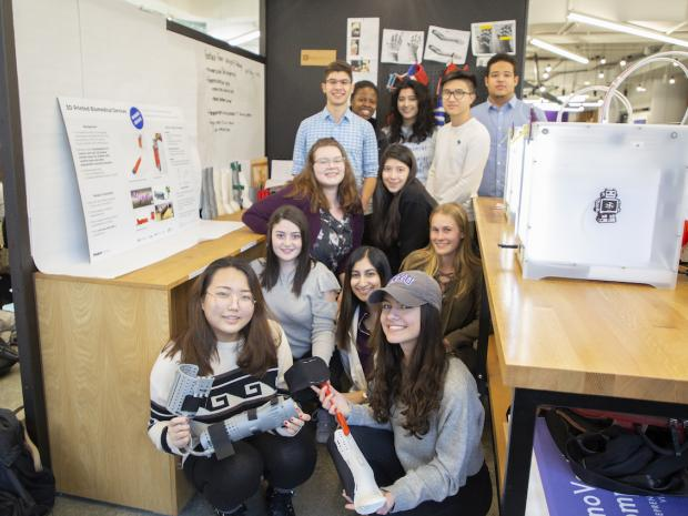 group of smiling students in makerspace