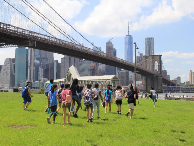 students participating in the data collecting soundwalk under the Brooklyn Bridge