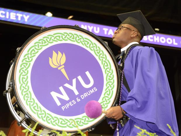 black student playing drum at graduation