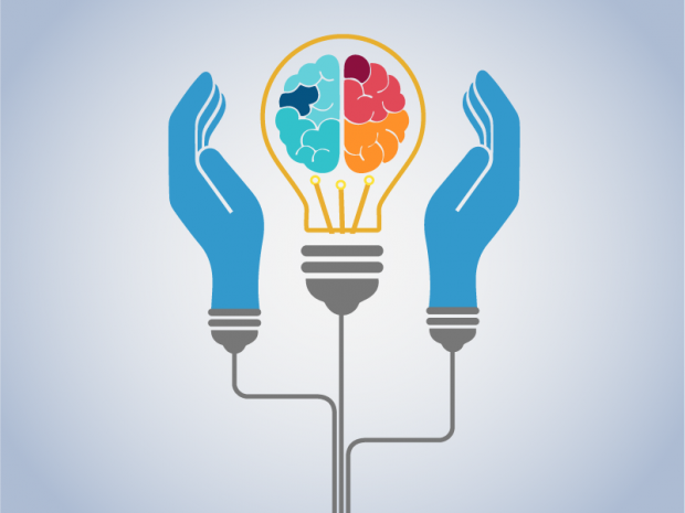 Two hands holding up a light bulb with a brain inside. Symbol of intellectual property