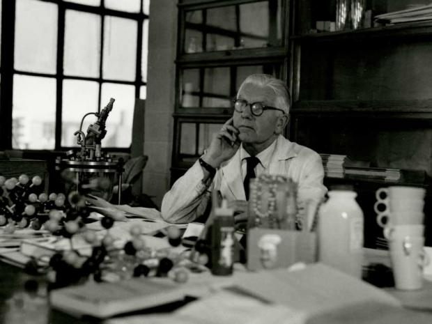 Herman Mark at desk; photo credit: Poly Archives