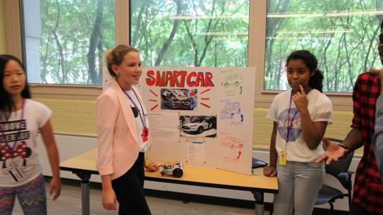 Science of Smart Cities students show off their own self-navigating smart car.