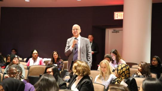 NYU President Andy Hamilton asking a question