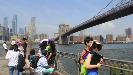 students performing experiments underneath the Brooklyn Bridge