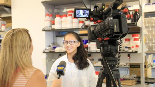 student being interviewed in a lab