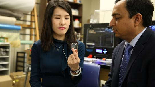 Ph.D. student Fei Chen and Prof. Nikhil Gupta in the lab