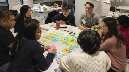 students using post-it notes to hack climate change