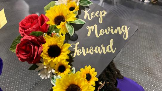 "Graduation cap decorated with message ""Keep moving forward"""