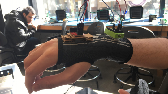 a human hand wearing a sensor laden glove