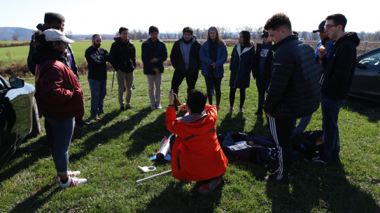 Students in a field testing their rocket