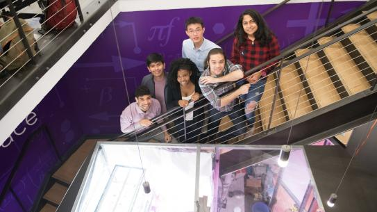 Students posing on the stairs of the MakerSpace for the Brooklyn Showcase