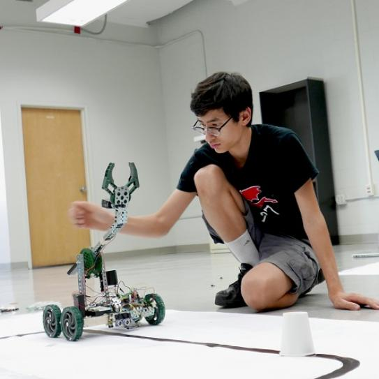 STEM student with robot