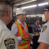 Tony Abdallah coordinating activities with NYPD following a G train derailment.