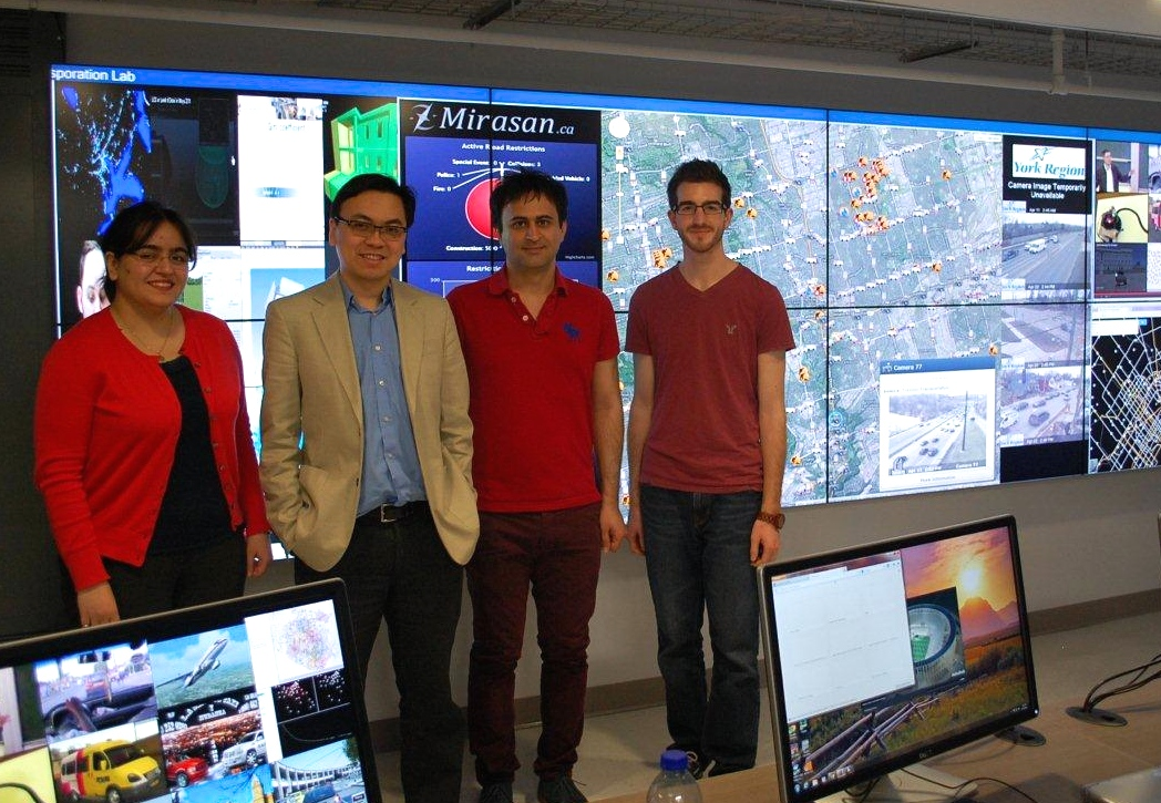 group standing in front of a screen displaying map data