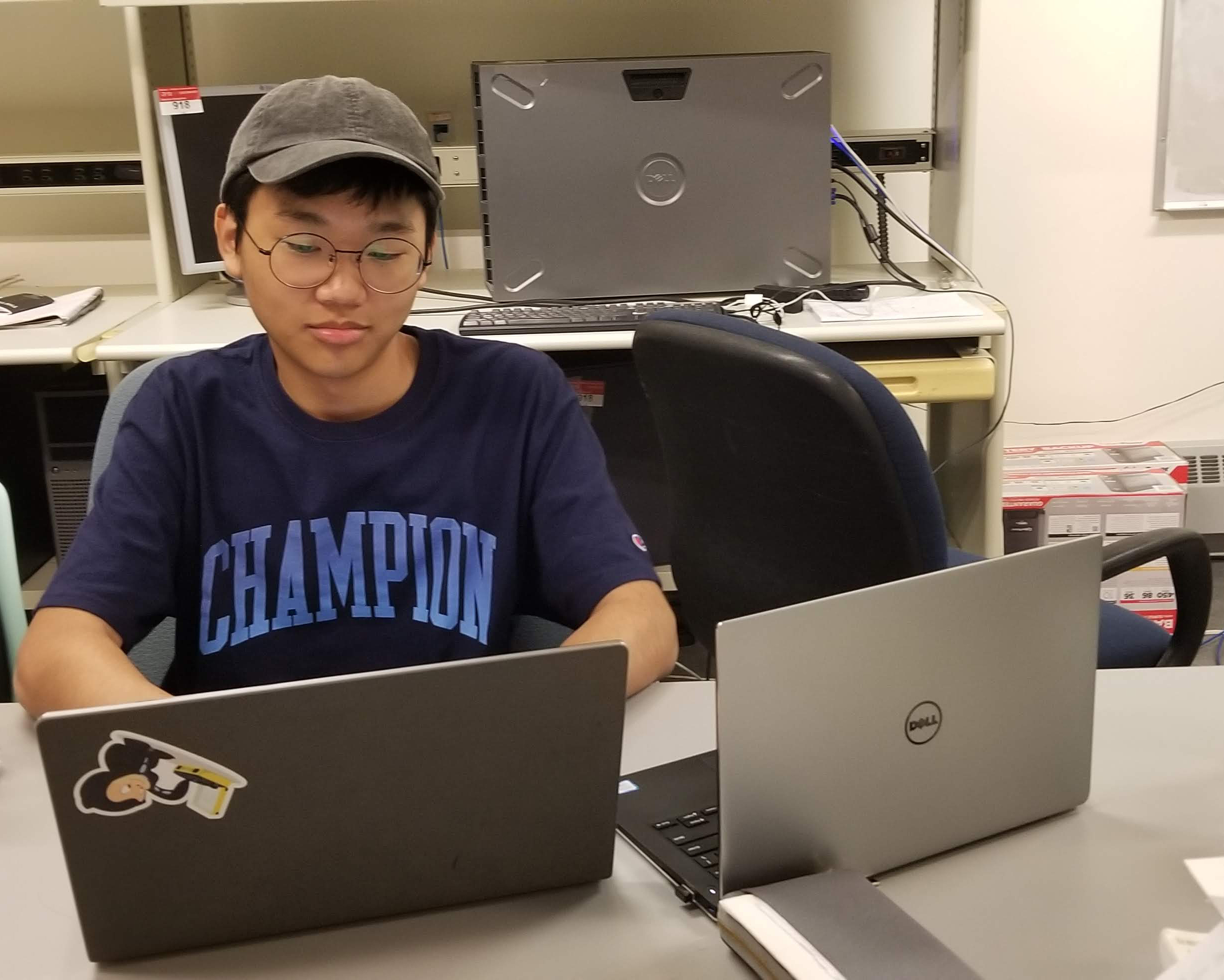 student working on laptops