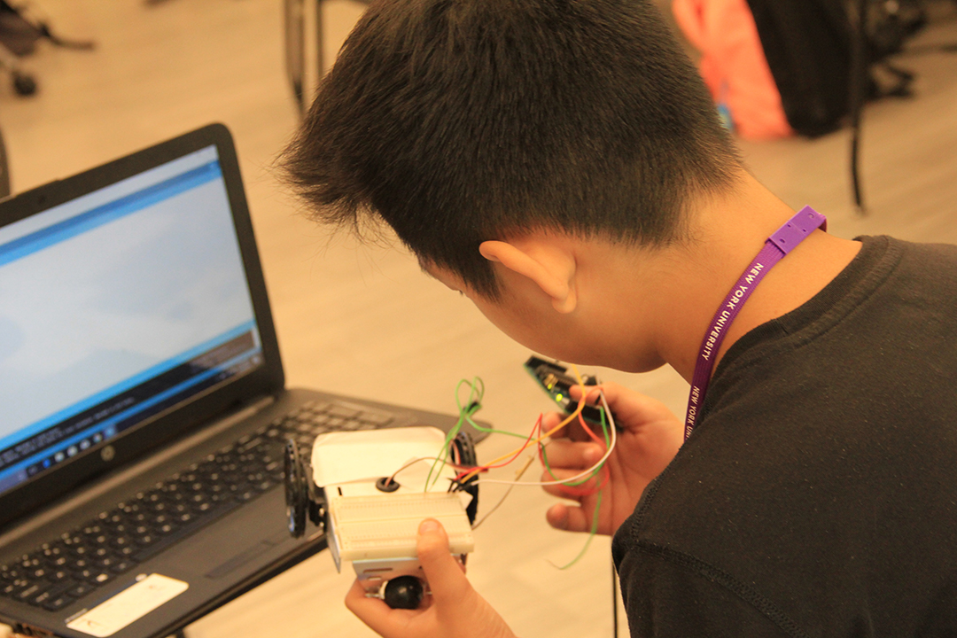 student examining a circuit