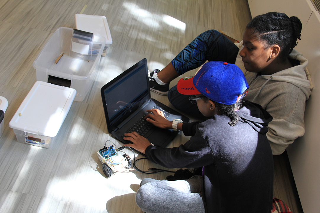 students coding together