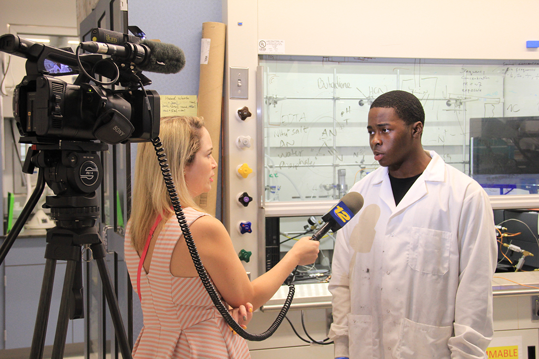 ARISE student being interviewed in a lab