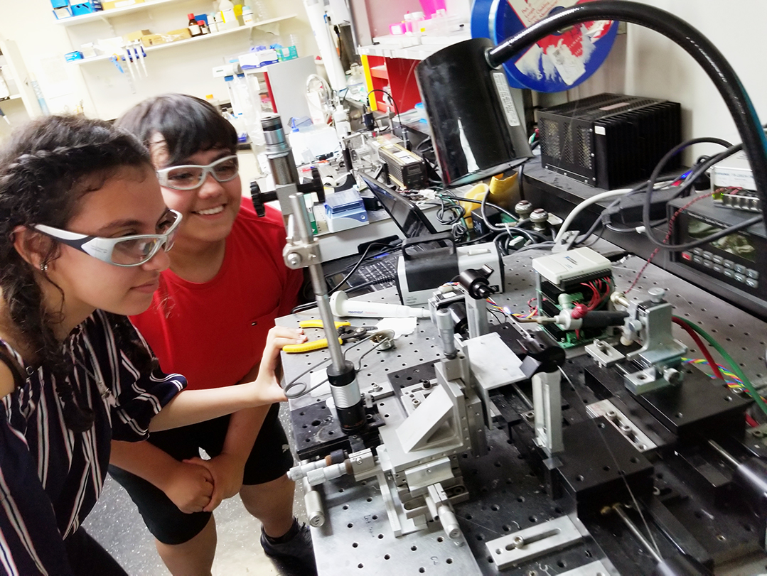 students working on machinery in a lab