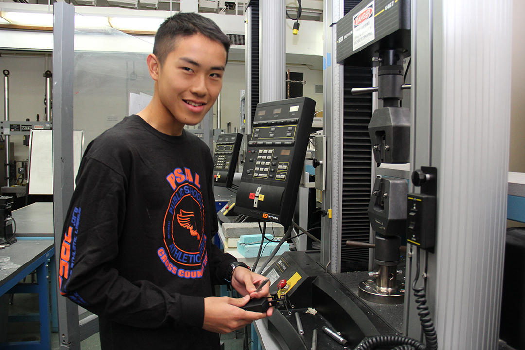 student working at a large computer in a lab