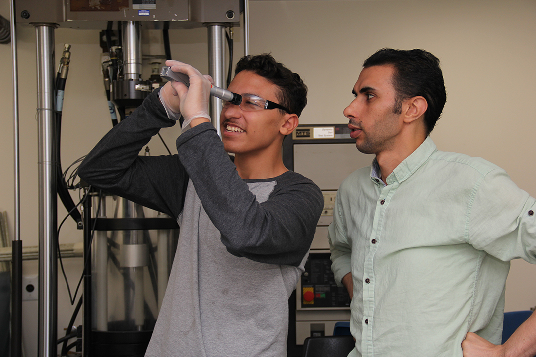 student and teacher in a lab